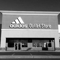 Adidas Outlet Store logo