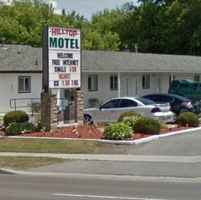 Hilltop Motel logo
