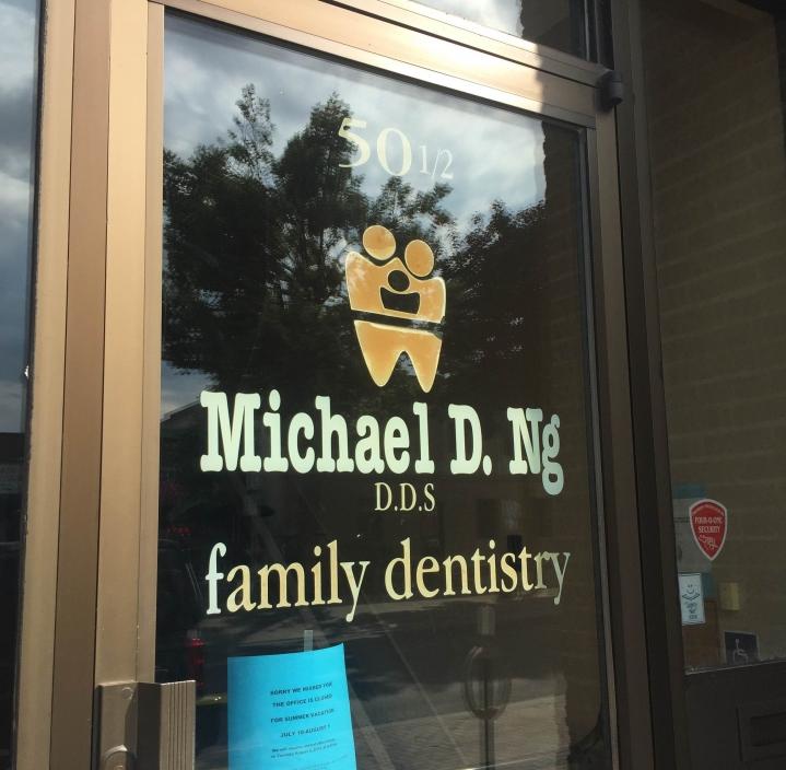 Ng Michael Dr - Dentist logo